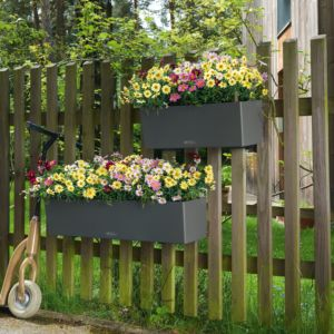 Jardinière rectangulaire résine grise avec supports, résistante aux intempéries, design, réservoir d'eau Plantes et Jardins Jardinerie en ligne